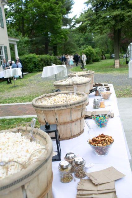 26 Wedding Reception Popcorn Station Ideas. Old fashioned market bushel baskets make wonderful rustic popcorn holders.