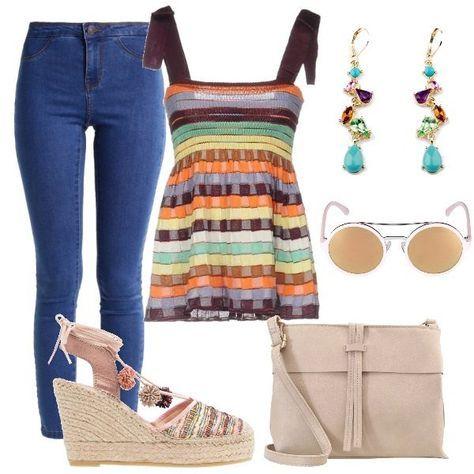 L'outfit+è+formato+da+un+paio+di+jeans+slim+fit+elasticizzati,+un+top+lavorato+a+maglia+in+fantasia+multicolore+Missoni+ed+un+paio+di+zeppe+con+pon+pon+in+pelle.+Gli+accessori+completano+il+look:+la+borsa+a+tracolla+color+taupe,+gli+occhiali+da+sole+con+lenti+a+specchio+e+degli+orecchini+con+pendenti+dal+sapore+vintage.