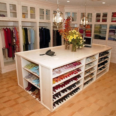 Closet - shoe storage  Ahhh, my dream closet; andI believe it would be of many others too. This is a great example for a store fixture layout to showcase merchandise. They have also used the rainbow effext to display theshoes and clothing by colours. It looks really clean and elegant and would work well in a retail setting as it does in a home closet.