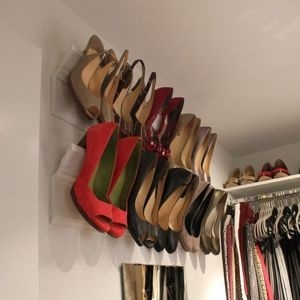 ...came across this ingenious idea for organizing your high heels using decorative crown molding!