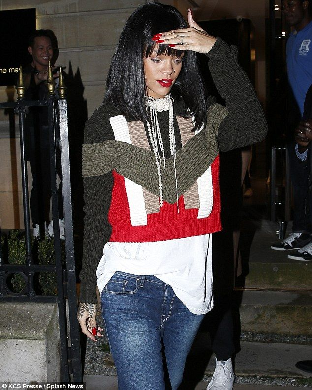 Covering up: Rihanna cut an unusually demure figure as she visited Montaigne's Market store on Tuesday night in Paris, France