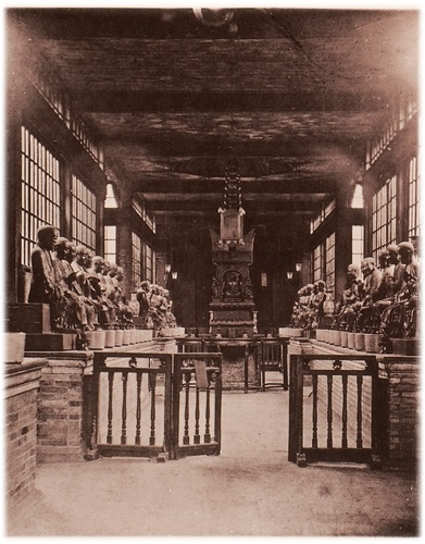 This photograph was taken by the British photographer John Thomson around 140 years ago during his travels through China. It shows an interior view of 'hall of gods' in the Buddist 'Temple of the 500 Gods' or 'Magnificent Forest Temple'. Nowadays this early temple is most often referred to as the Hualin Temple.