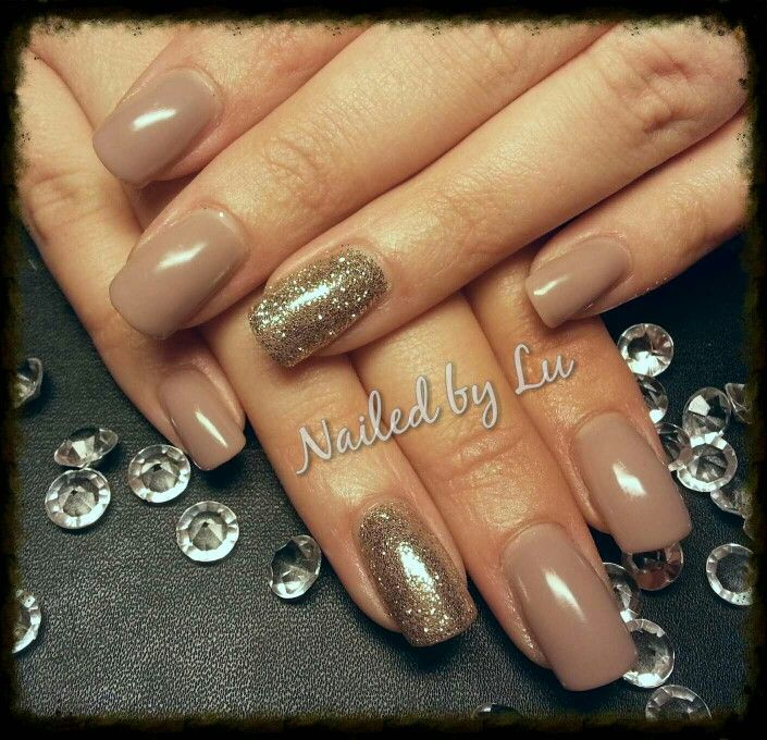 Taupe gel polish with pressed gold glitter acrylic nails