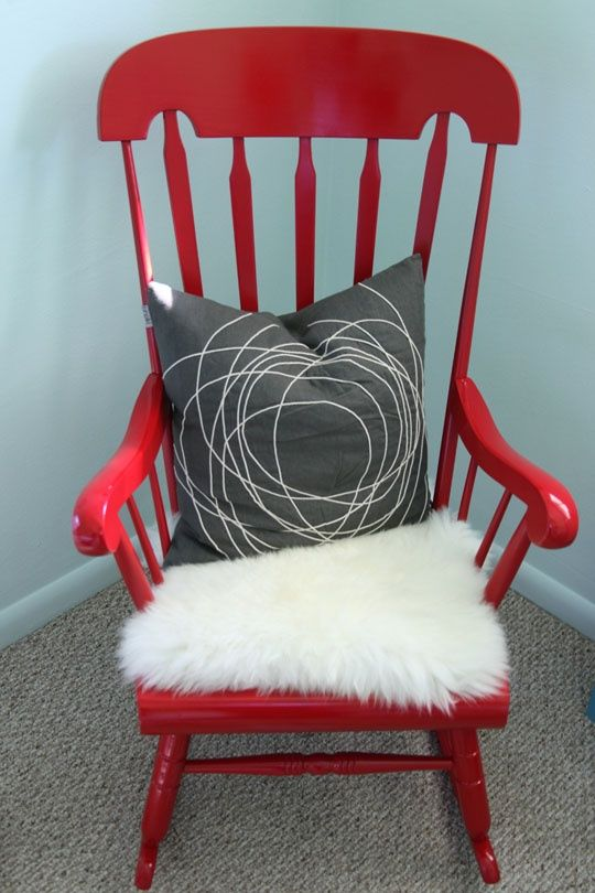 A glossy red rocking chair