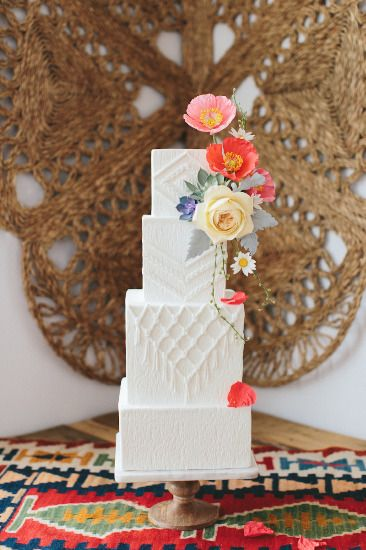 Southwest-inspired boho wedding cake. Bohemian. Fabric looking part on outside of white top layer of cake