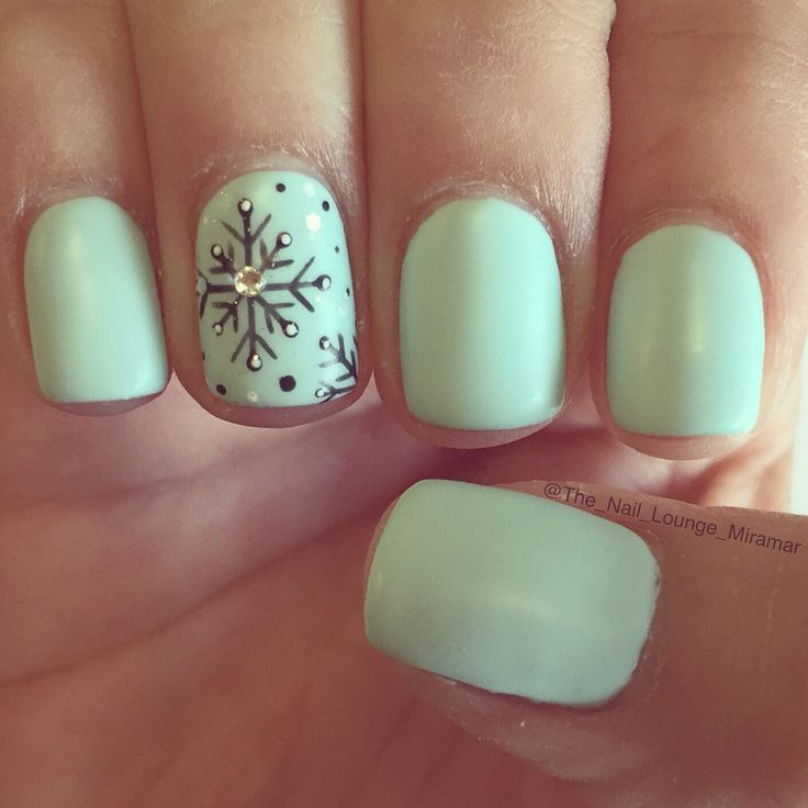 Mint green snowflakes nail art design...