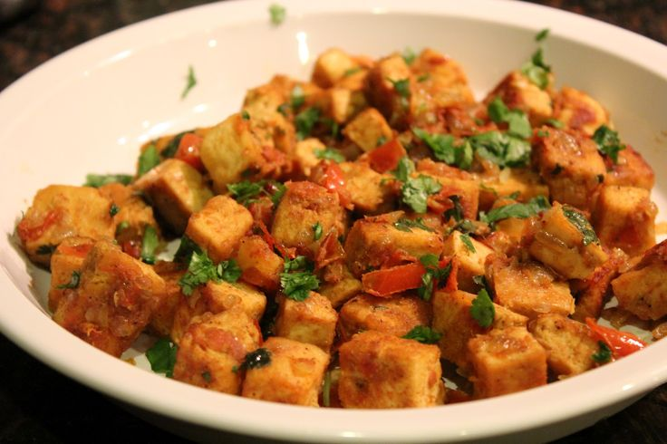 Indian Curried Tofu Recipe on Honest Cooking - Delicious recipe!  Put mashed sweet potatoes, tofu, and chickpeas on a tortilla for Indian curried tofu tacos!