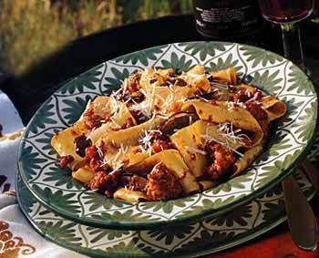 Pasta with veal, sausage and porcini ragu Save Print Ragù is a beloved part of Tuscan cooking. Every person has his or her own recipe, but the basics are constant: It is a hearty sauce made with meat (beef, pork, veal, duck, even boar) and vegetables like carrots, tomatoes and onions, all cooked in wine and broth. And ragù is most often served over pasta. This recipe includes dried porcini mushrooms, which give the sauce a real taste of the Tuscan countryside. Author: Bon Appétit May 2000…