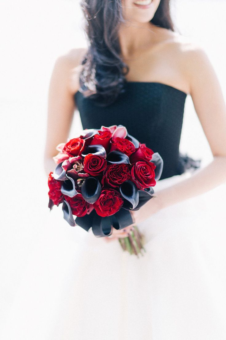 The bride wore a black-and-white wedding dress and carried a bouquet comprised of red roses and orchids, as well as modern black calla lilies. #WeddingBouquet Photography: Joseph Lin Photography. Read More: http://www.insideweddings.com/weddings/bride-wears-black-and-white-wedding-dress-to-new-york-city-nuptials/658/