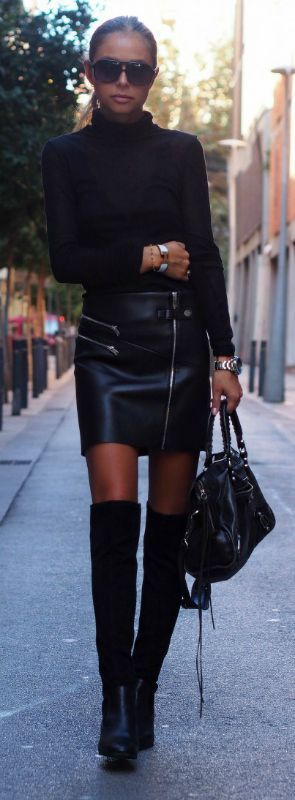 Maria Kragmann wears a pair of over the knee boots with a leather mini skirt   and a turtle neck top; the ultimate rocker look.   Top: American Vintage, Skirt/Boots: Zara, Bag: Balenciaga.: