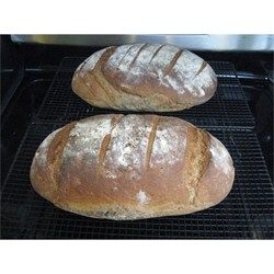 Here is a great recipe for authentic German Sourdough Bread. This bread tastes almost exactly like the bread we buy back home in Bavaria, Germany. There, to this day, they bake their bread in a very old stone oven in the middle of a small village, once every 2 weeks. They bake a whole bunch at once, and then you can buy it and freeze extras until the next baking day. It's the best German bread I know!