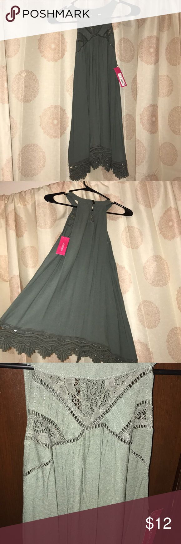 NWT high neckline blouse with lace Brand new with tag, beautiful army green flowing blouse with high lace neck line and lace bottom trim. Xhilaration Tops Tank Tops
