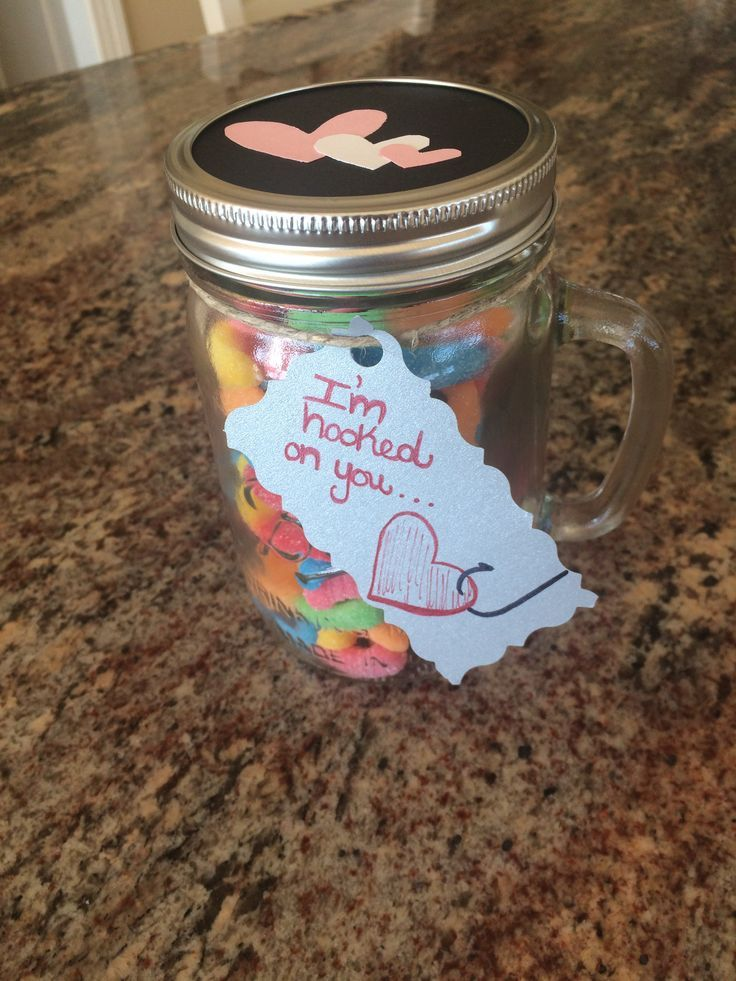 "Homemade Valentine's Day gift for my boyfriend. A mason jar that contains sour gummy worms and says ""I'm hooked on you"". Super cute and easy t"