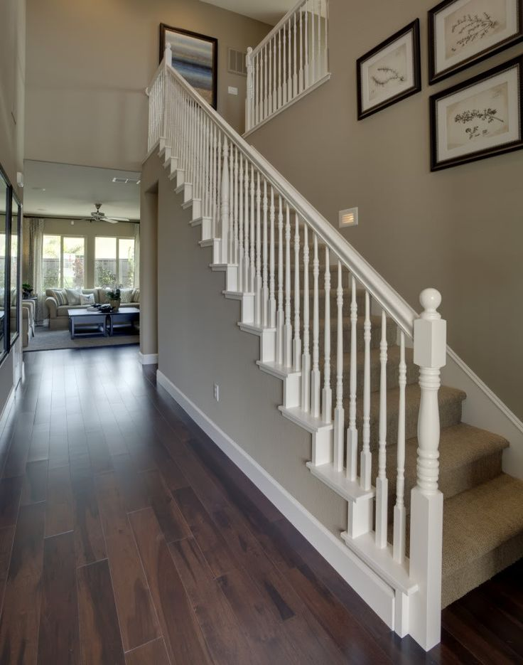 Love the white banister, wood floors, and the Wall color, exactly what I want to make mine look like!!