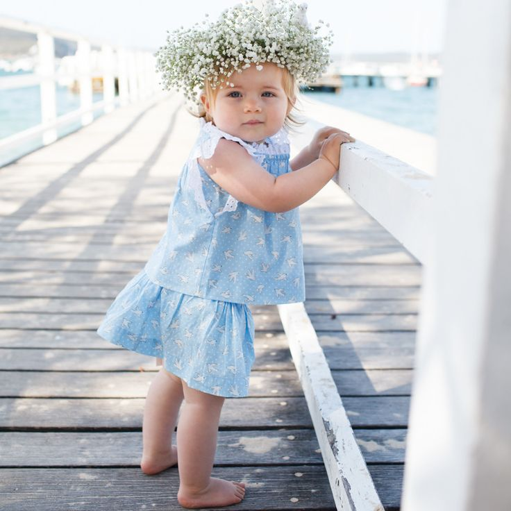 Features elasticated waist for comfort and pretty little side tie detail on the waistband with a clever inbuilt bloomer to cover those little nappies. Generous fit with soft elastic in both waist and around the bloomer legs. Matches our 'Miss Polly' smock top perfectly.  French seamed.