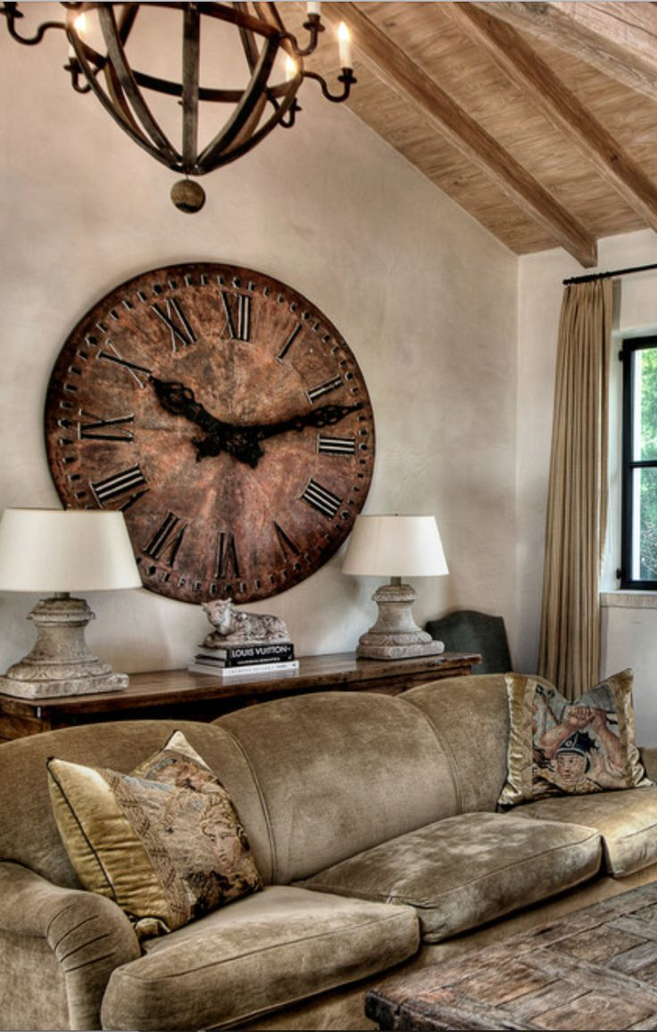 Certainly a statement piece, that clock.  Fits gorgeously with the room's colour scheme.