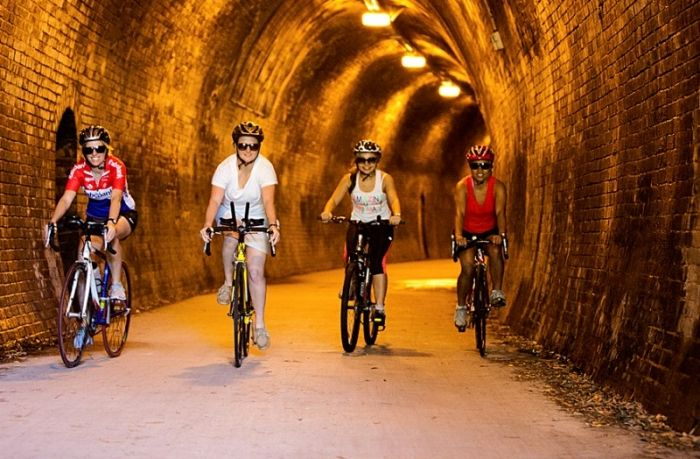 Cycling through the Fernleigh Tunnel rail trail and foreshore, Newcastle Australia. Cycle Traveller