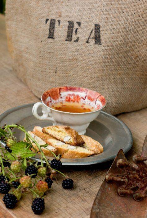 """tea and biscotti. #tea""~ and a beautiful orange tea cup!"