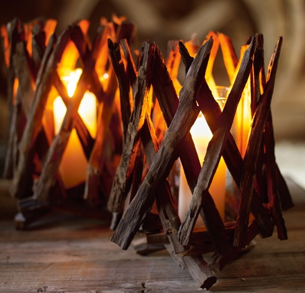 cross-hatched wood creates filtered candlelight - could be fun to make these out of driftwood this summer