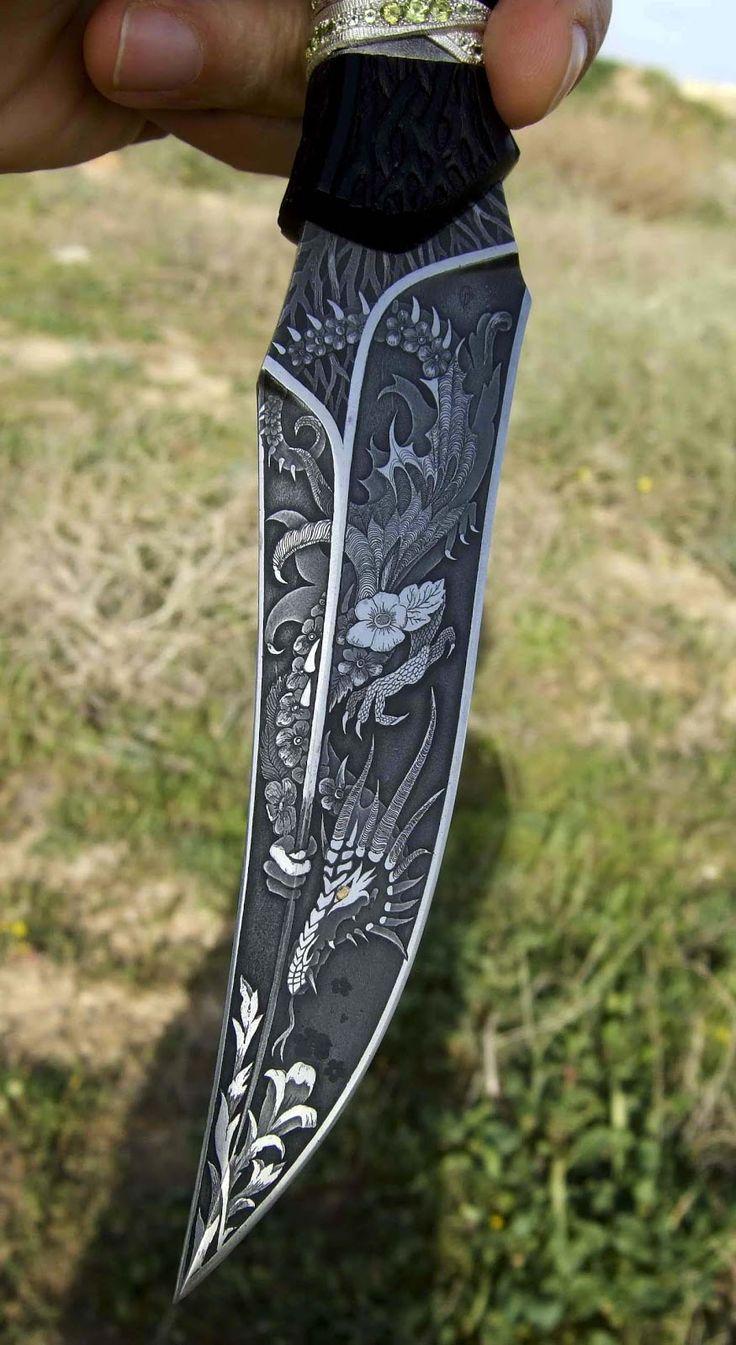 Knifemaker O. Goushchin.   95X18 steel, titanium, silver, gold, ebony (ebony).  The engraving, inlay, artistic etching, wood carving.