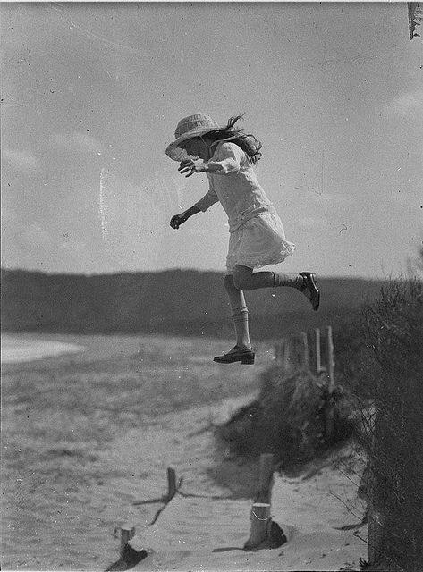 Unidentified small girl leaping onto the beach, c. 1930s, by Sam Hood by State Library of New South Wales collection, via Flickr