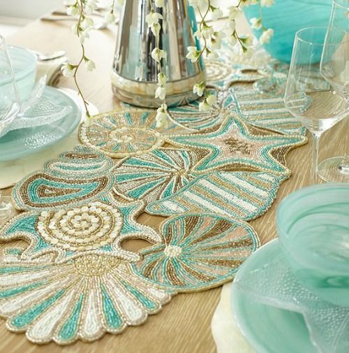 Pier 1's beaded seashell table runner. Now on sale: http://www.completely-coastal.com/p/coastal-sale-island.html