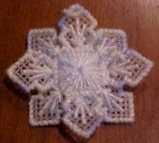 Snowflake Ornament    This simple little pattern makes a wonderful 3-dimensional snowflake ornament. The only materials necessary are a sheet of 7-count plastic canvas and a skein of variegated yarn, preferably some combination of white and blue. The sample shown in the picture uses a blue, white, and silver variegated yarn.          Cut out two snowflake shapes using this guide.      Using the variegated yarn, stitch each piece as shown. Overcase all edges with the same yarn.      Turn one…