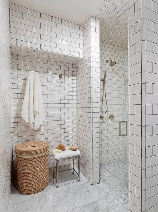 Fabulous Bathroom Features Floor To Ceiling Walls Clad In White Subway  Tiles Accented With Gray Grout Lined With A Round Woven Hamper And A  Restoration ...