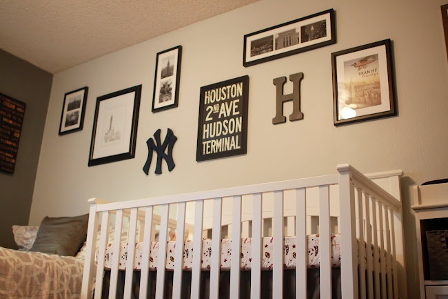 Black, white and gray. Yankees logo (not us), lots of square angles, frames. Good look for NY bathroom.