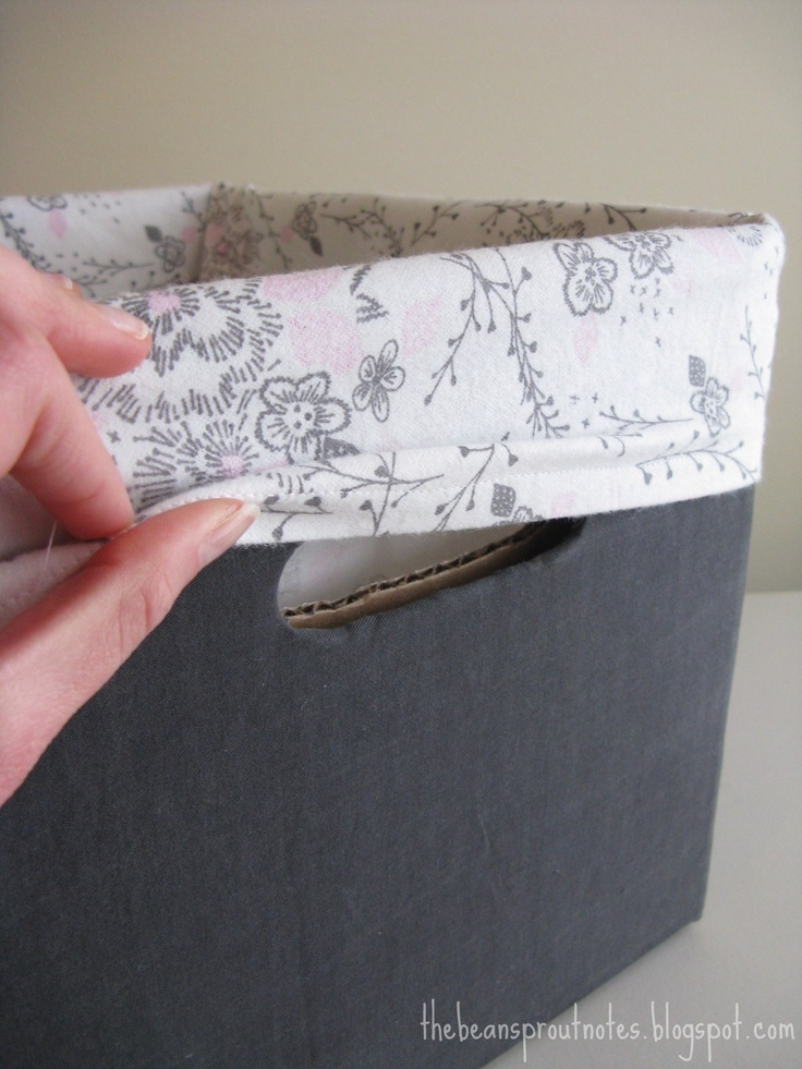 Fabric lined diaper box. Great for storage!