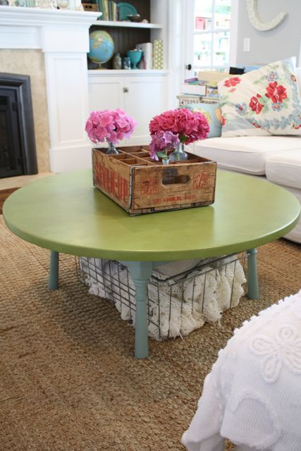 love this round coffee table with a basket underneath and simple centerpiece. would serve well in our home!