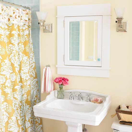 The blue-gray tile in this bathroom is pretty much identical to ours - great color combo with the pale yellow!