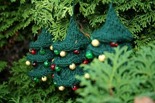 Twisted Christmas Tree - I'm addicted!  Free ravelry download.
