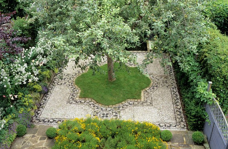 A taste for the Alhambra and the desire for a sanctuary after a long day's work inspired this Moorish garden. Tiles, grass, pavers and pebbl...
