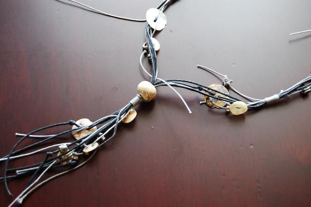 Handmade necklace made of wire, with variety of metal, horn and ceramic beads. by Kosmisis on Etsy