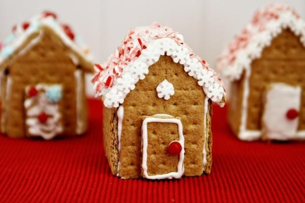 Has iciing recipe! Graham Cracker Gingerbread Houses via celebrations.com #christmas #editorspick