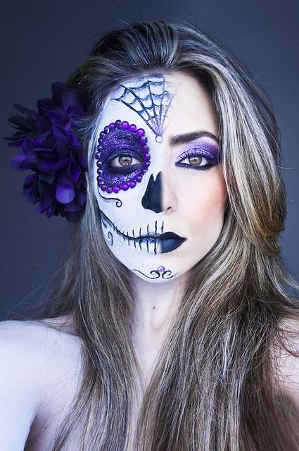 "Creative purple half Dia De Los Muertos make-up with purple crystal accents, titled ""Life and Death!"" by Larissa Grace."