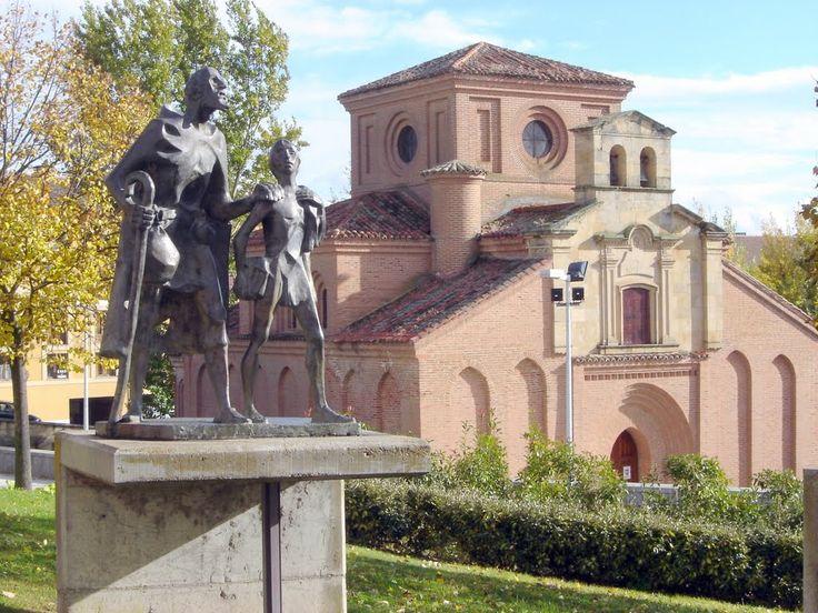 Salamanca - statue of Lazarillo de Tormes leading the blind man and Iglesia de Santiago