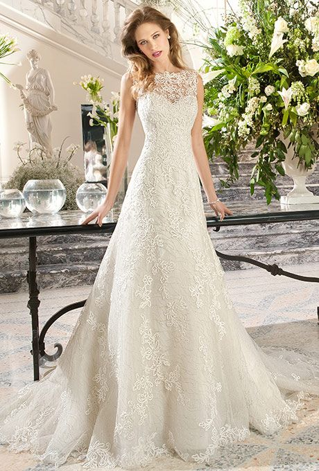 Brides: Demetrios - Couture. This timeless, a-line, gown features delicate embroidered lace with a sweetheart silhouette and illusion lace overly creating a bateau neckline. The illusion lace back features a button closure.