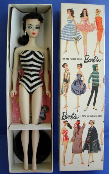 The first Barbie doll - I remember it so well; the box, the swimsuit, and who could forget that face?!