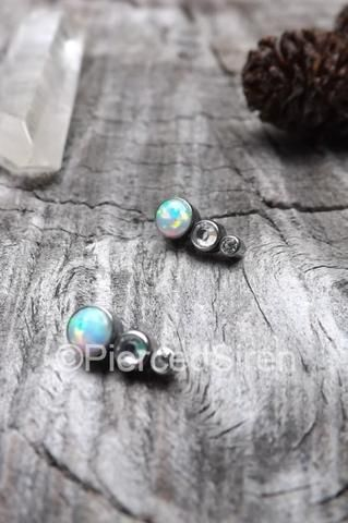 SirenBodyJewelry.com, pin for later. Helix piercing opal cluster three gem earrings flat back helix tragus bars conch clusters stud ring ear ring body jewelry triple forward 1