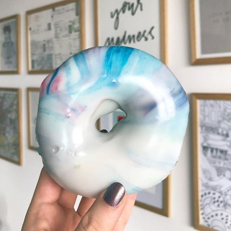 """In honour of Friday and our most recent design collaboration with #Bangarang; in two words their design """"just go"""" encapsulates an entire world of possibilities. Hence the galaxy inspired doughnut. . They chose these words in honour of their good friend and donating proceeds to @headway_uk a brain injury association. . . #zealandheart #travel #passport #wanderlust #travelinspired #howihue #happyselves #whenpeoplematchplaces #realoutfitgram  #beautifuldestinations #luxurylifestyle…"""