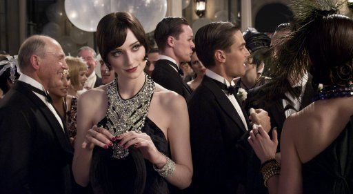 """One way contemporary style was incorporated was by collaborating with Italian designer Miuccia Prada on some of the female costumes. """"Miuccia designed 40 of the background dresses for the party scenes. - The Great Gatsby"""