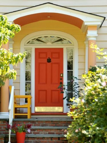 Paint your facade in sunset-like hues that warmly welcome you home in the evening. See more colorful doors >>