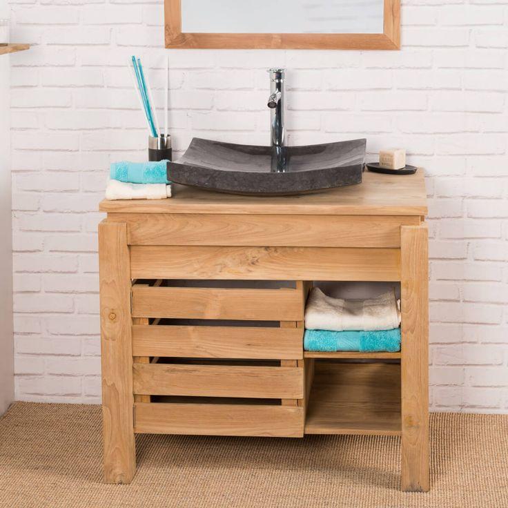 Ce magnifique meuble en teck massif est parfait pour créer un espace naturel dans votre salle de bain. Ce meuble sous vasque offre grâce à sa porte ajourée et ces deux niches un bel espace de rangement pour vos serviettes et accessoires de toilette.  N'hésitez pas à ajouter le miroir carré 70x70 pour plus de luminosité et la tablette Camélia parfaite pour déposer vos parfums! Idéal pour une vasque à poser.  Longueur : 85 cm Hauteur : 75 cm Profondeur : 55 cm