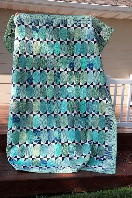 Tula Pink's Pancakes pattern in blues and seafoam. Great for batik scraps.
