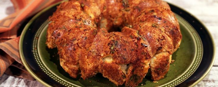 Clinton's Cheesy Herb Biscuit Monkey Bread.  Use package biscuits. Cut into quarters then freeze.