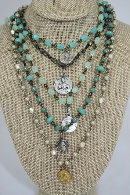 "Rosary Necklaces and Bracelets with Real Vintage Medals. http://www.dallysisters.com/vintaj-bracelets.html  use code ""20off"" for discount on Vintaj Jewelry Only."
