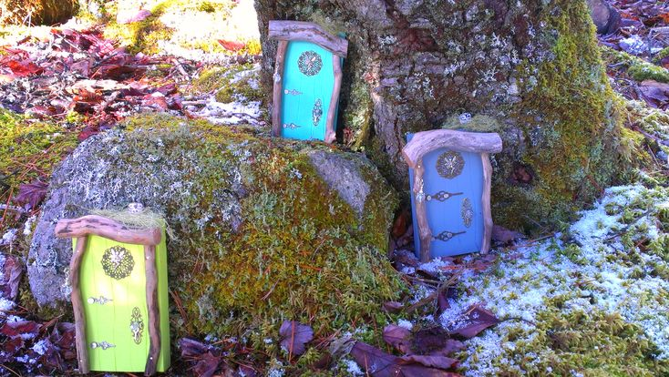 Fairy doors in a magical mossy forest