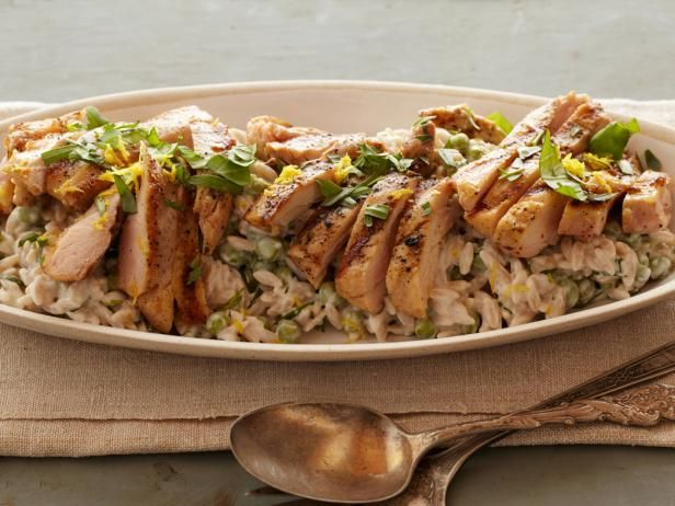 Get Food Network Kitchen's Creamy Lemon-Pepper Orzo with Grilled Chicken Recipe from Food Network